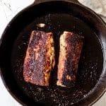 cooked Mahi Mahi fillets in a cast iron skillet