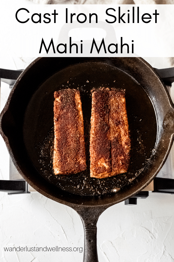 two mahi mahi fillets in a cast iron skillet