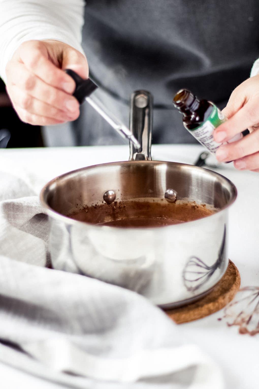 a woman adding drops of stevia