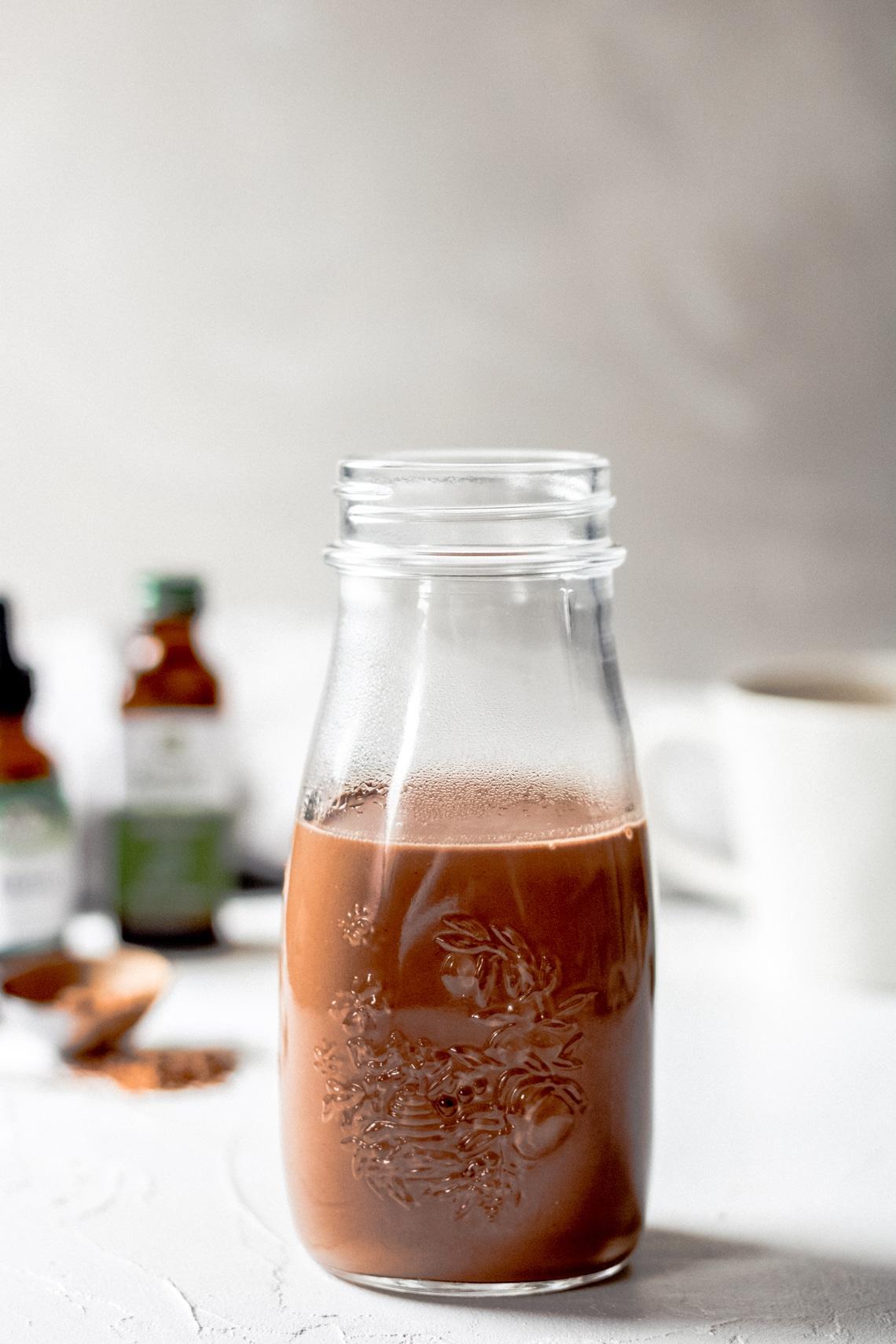 dairy free, sugar free mint mocha coffee creamer in a glass jar