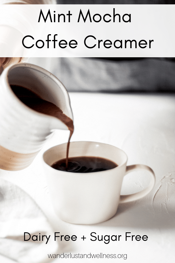 a woman pouring coffee creamer into a cup of coffee