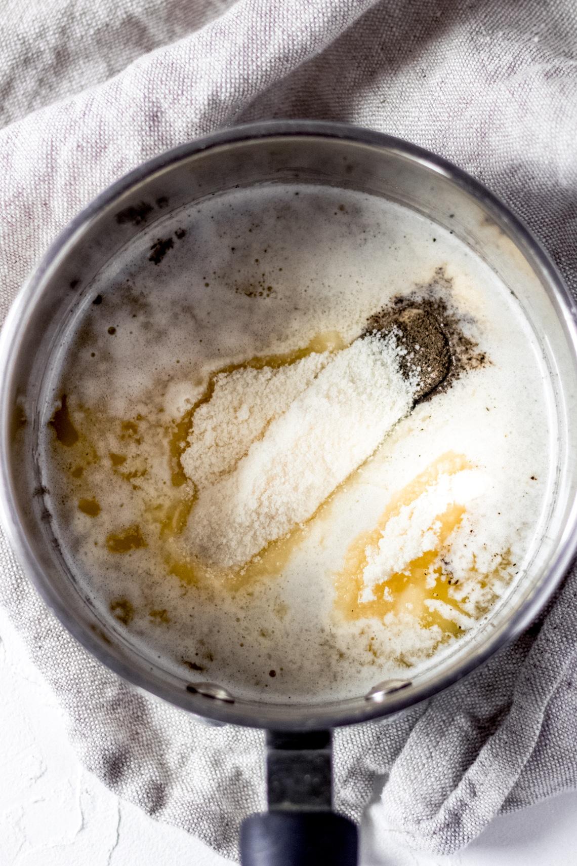 garlic parmesan sauce melting in a saucepan
