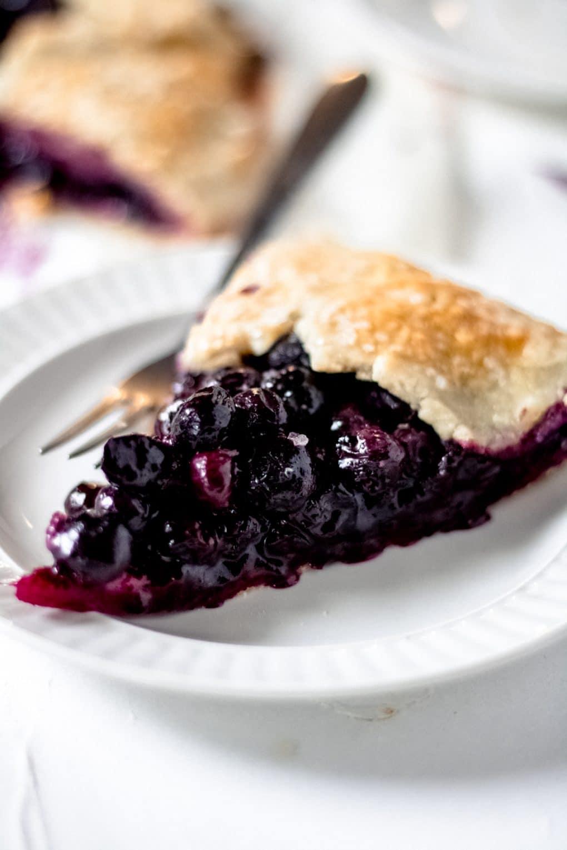 a slice of gluten-free blueberry galette