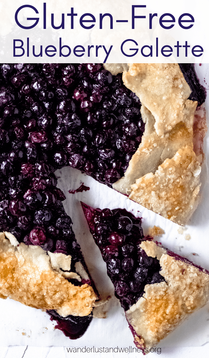 a gluten-free blueberry galette with one slice cut out of it.