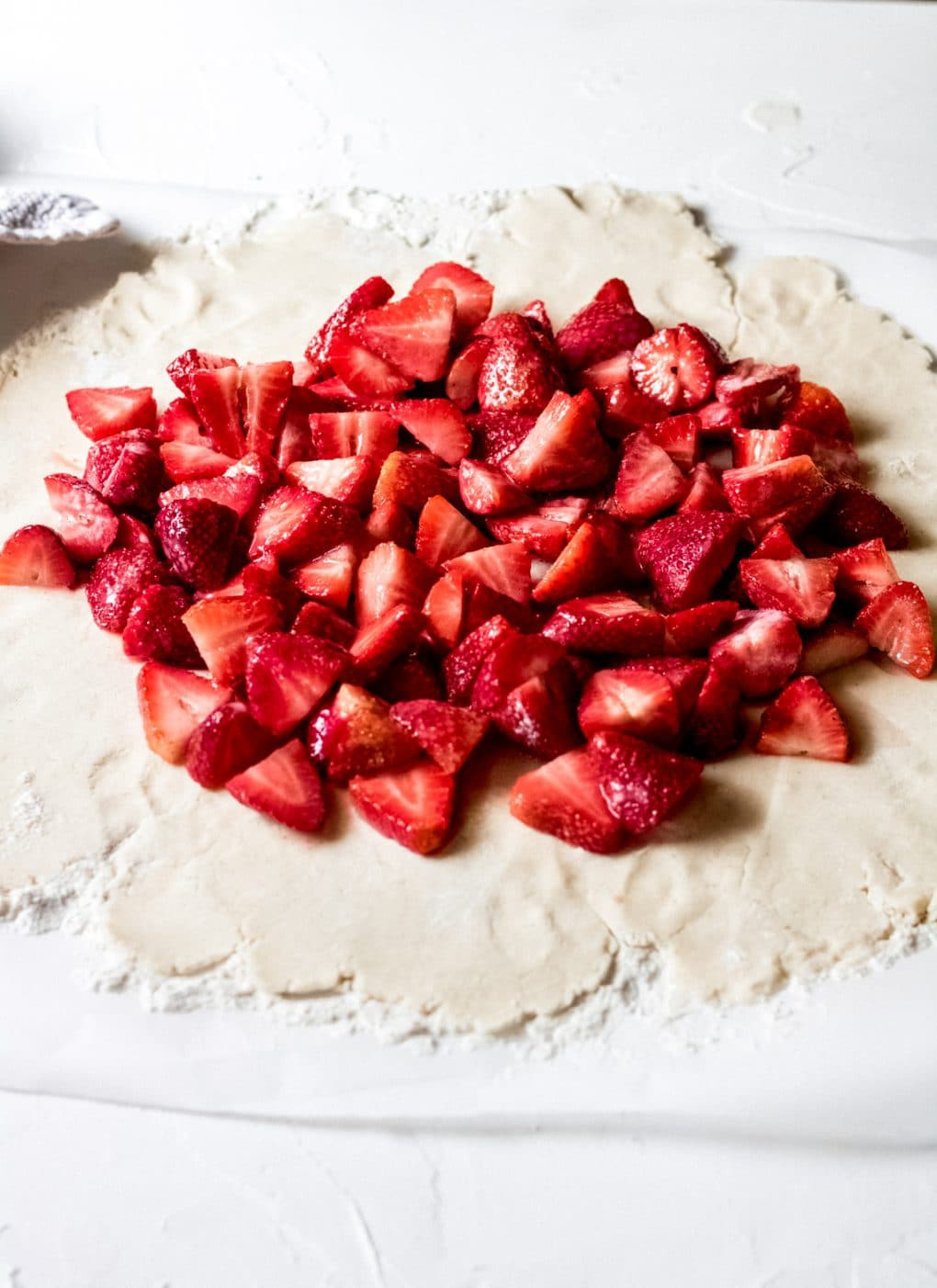 fresh strawberries on top of gluten free galette dough
