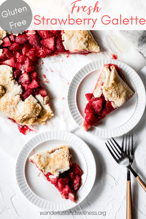 a gluten free strawberry galette with two slices on white plates