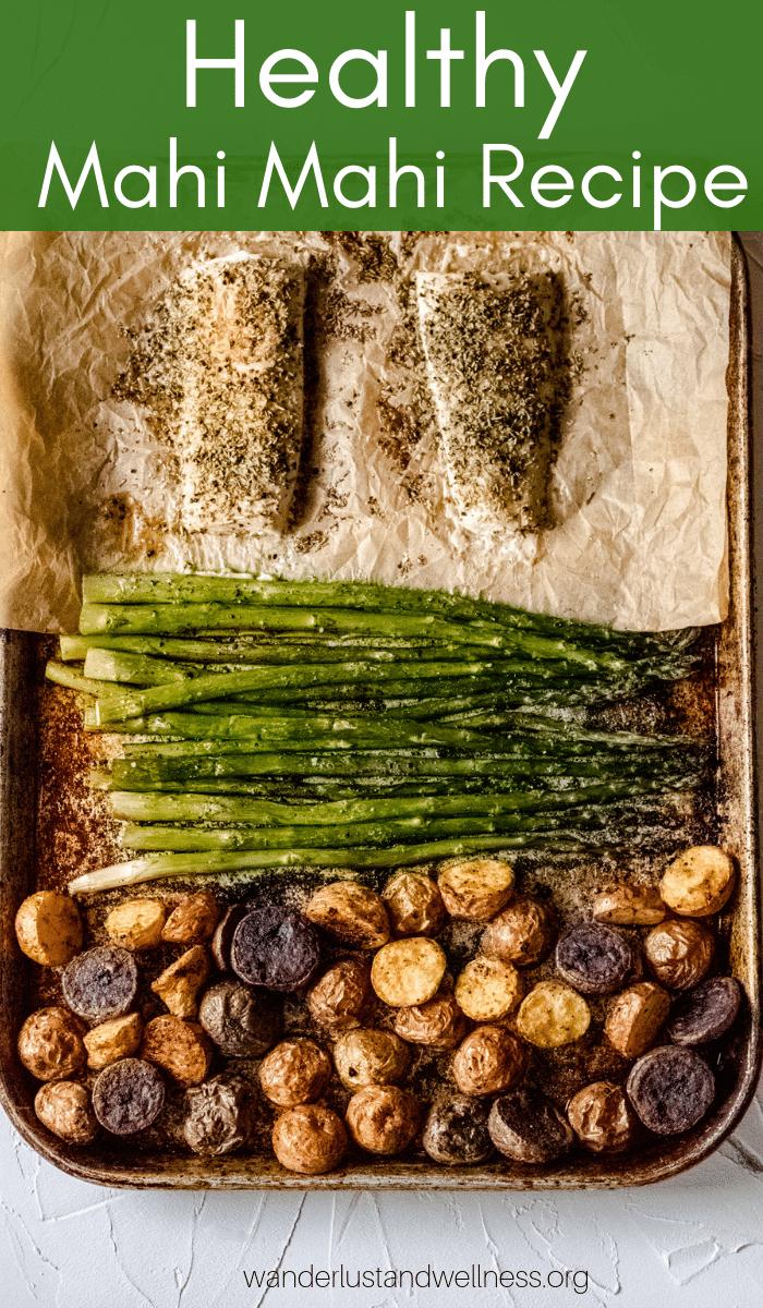 a sheet pan with potatoes, asparagus, and mahi mahi fillets
