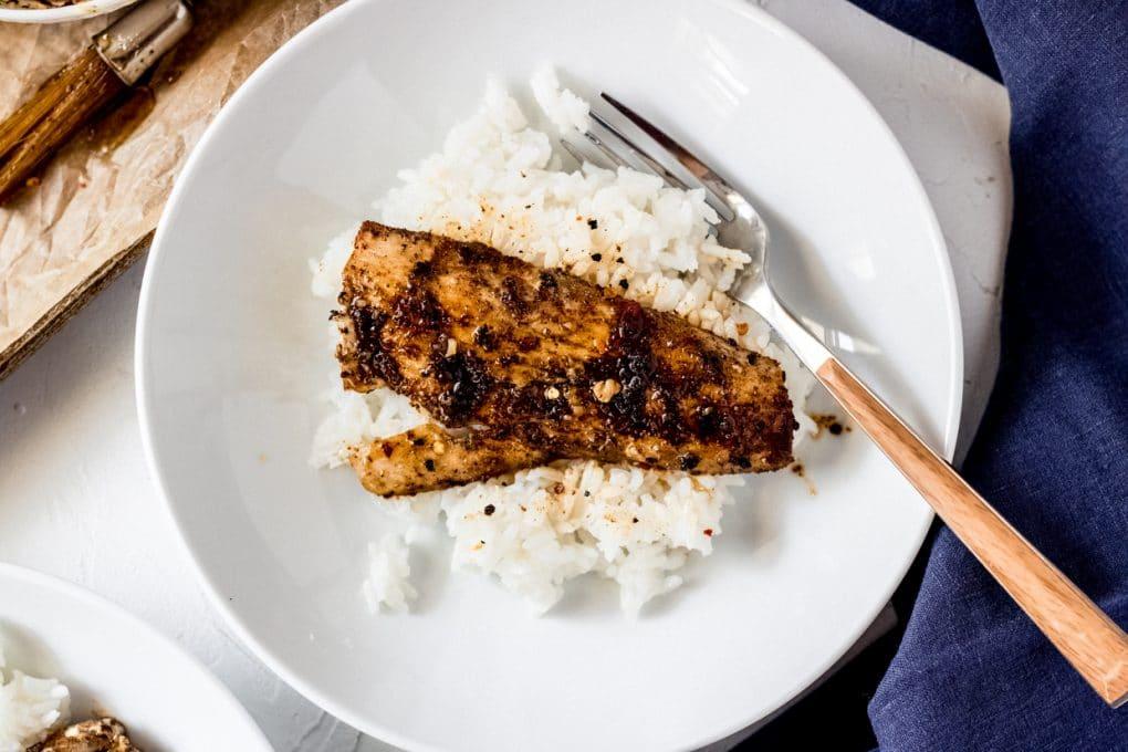 a honey lime mahi  mahi fillet on a bed of rice