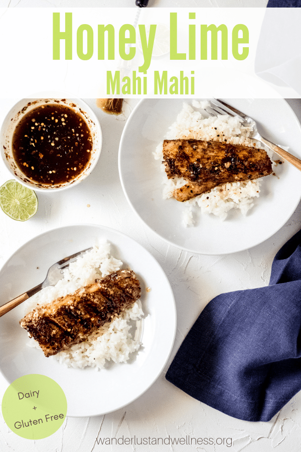 two honey lime mahi mahi fillets ove a bed of rice in white bowls.