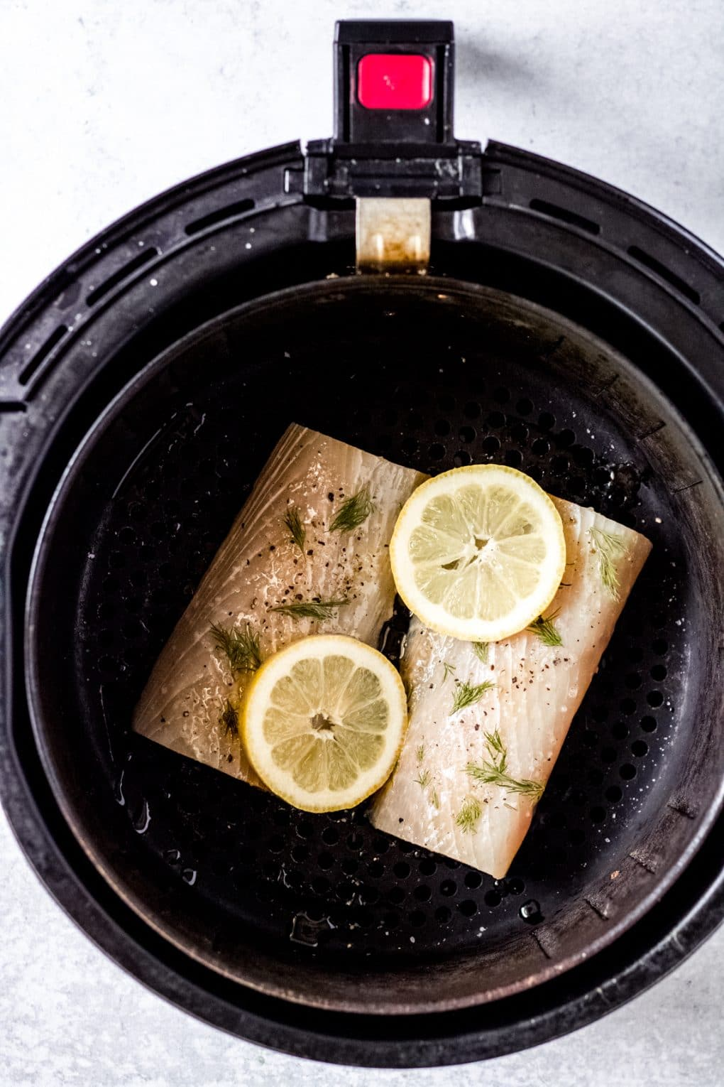 mahi mahi fillets in an air fryer basket