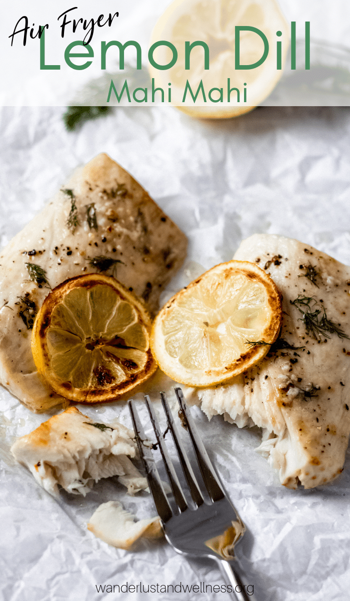 two fillets of lemon dill mahi mahi on parchment paper