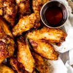 a bowl of chicken wings with maple syrup