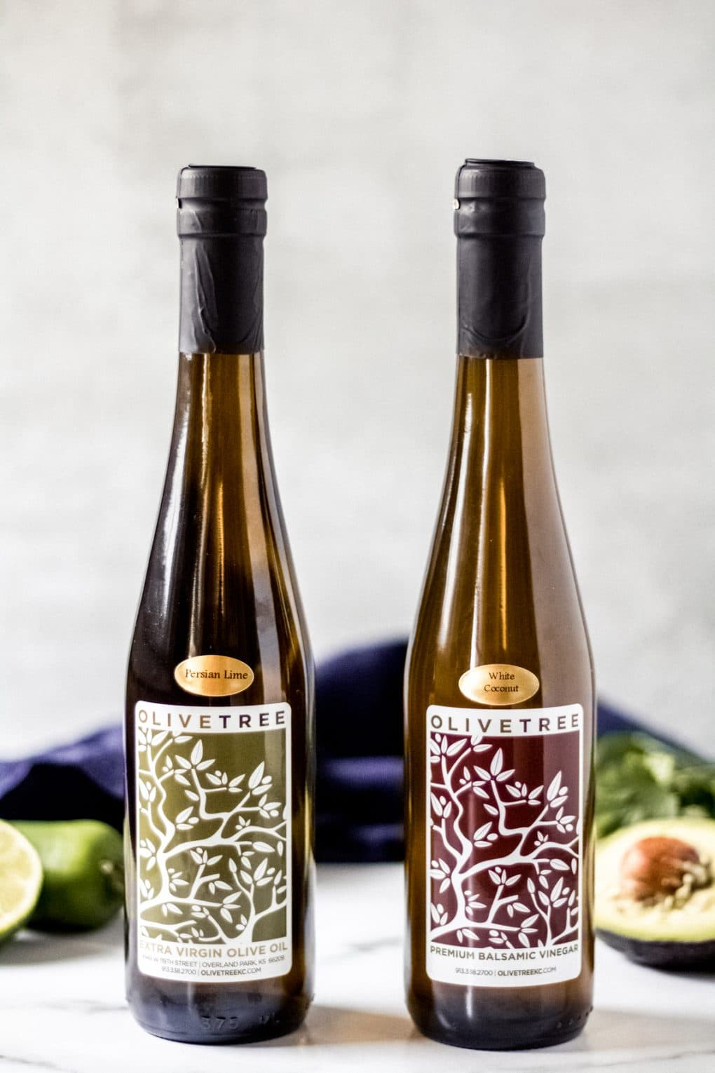 two bottles of olive tree products