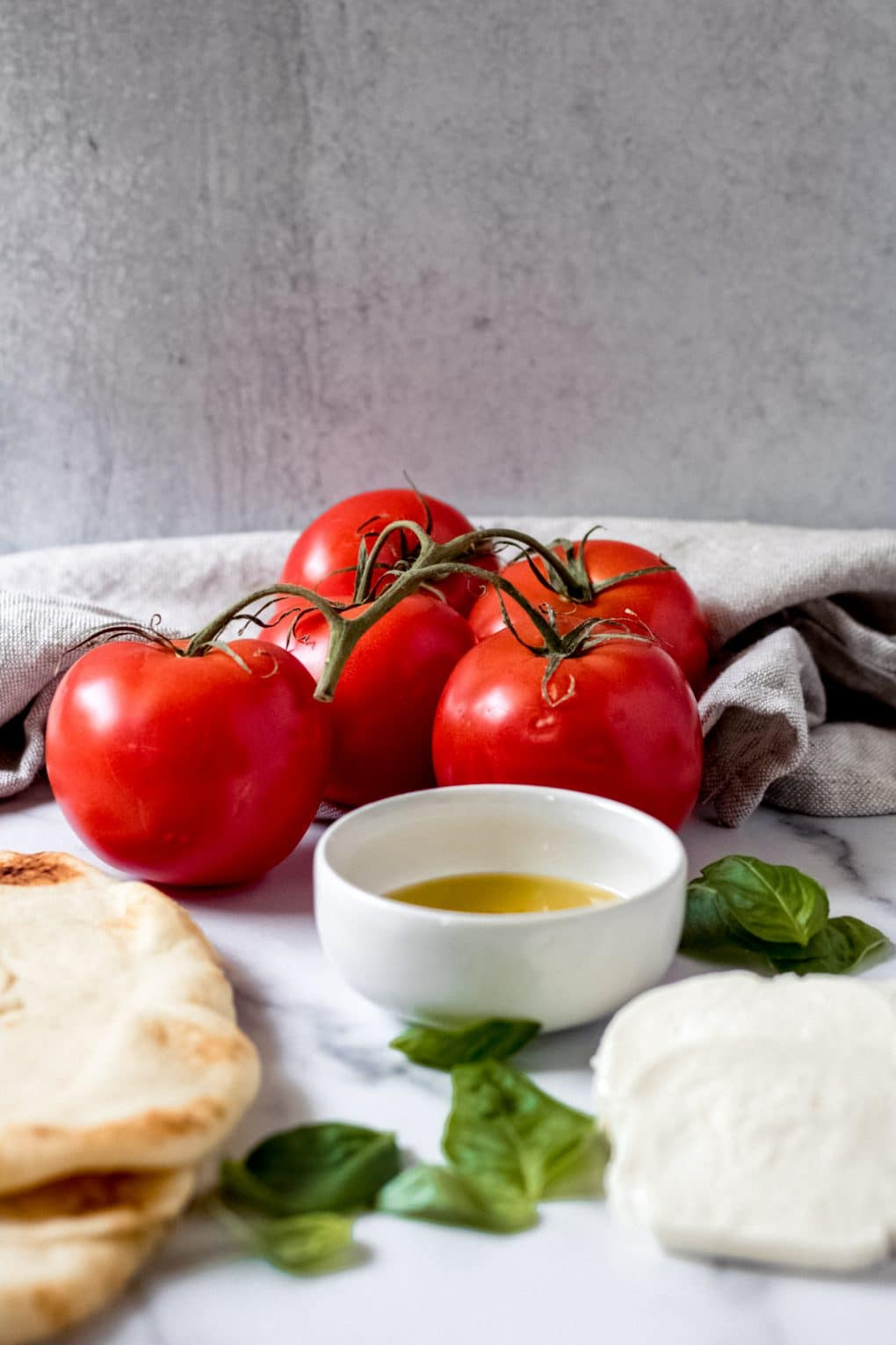 fresh summer tomatoes and other ingredients for pizza