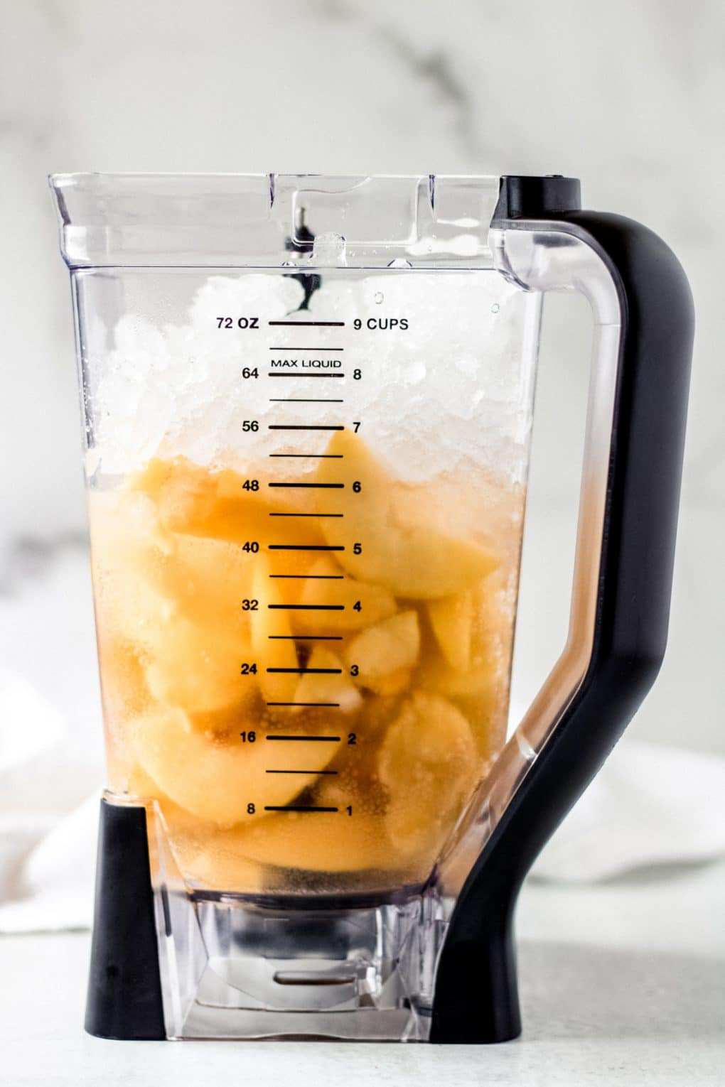 ingredients for a frozen peach bellini in a blender