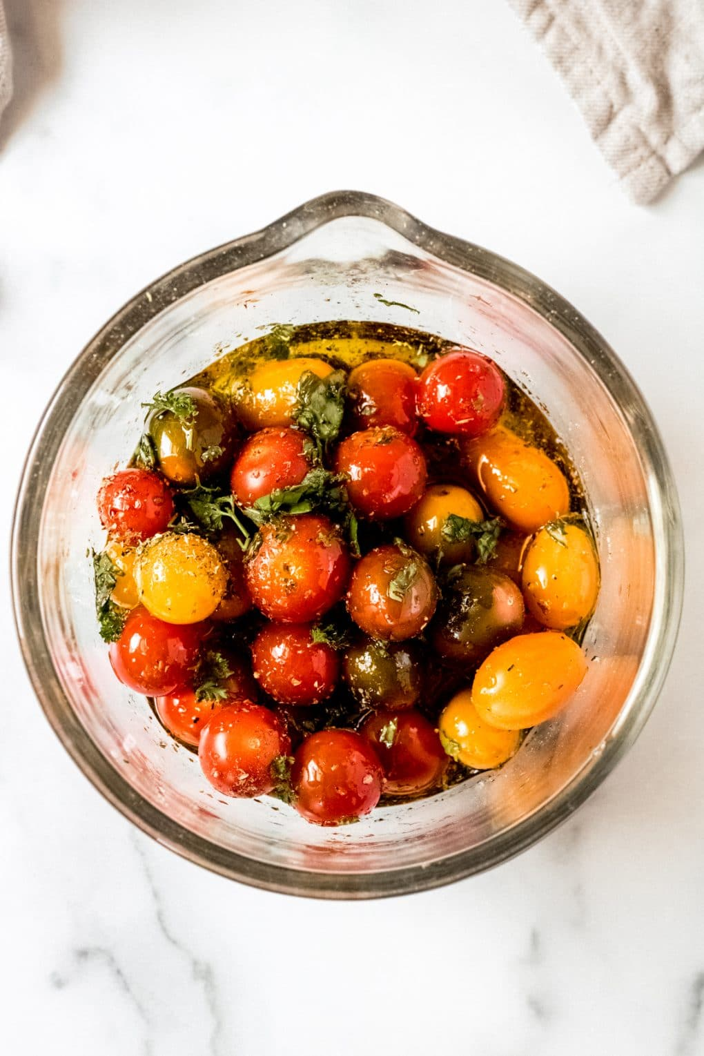 fresh tomatoes in a bowl marinating