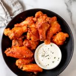 a bowl of oven fried chicken wings
