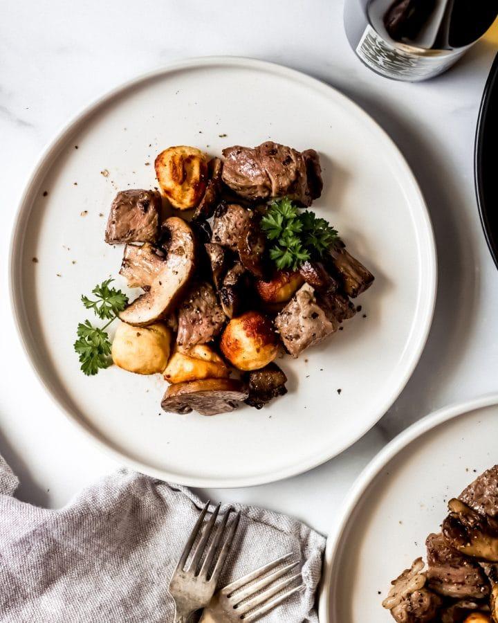 air fryer mushroom & steak bites on a white plate