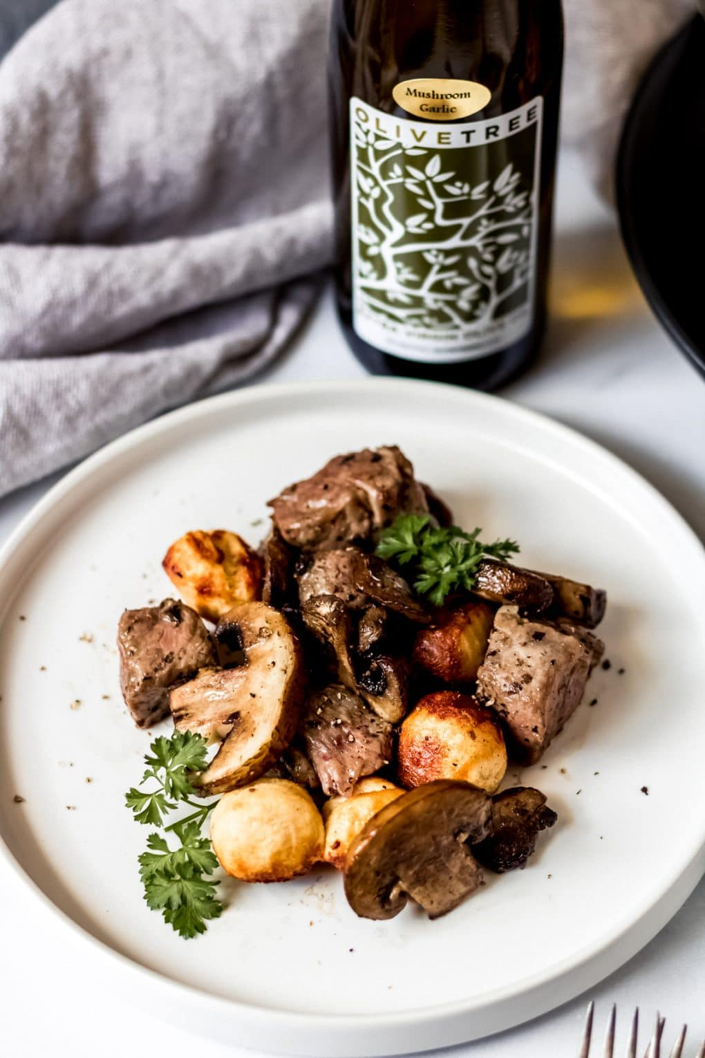 air fryer mushroom & steak bites on a white plate