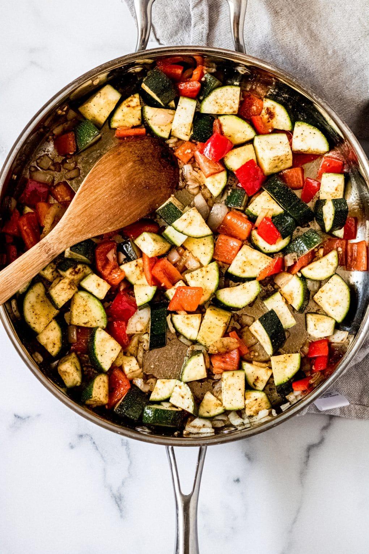vegetables cooking in a skillet