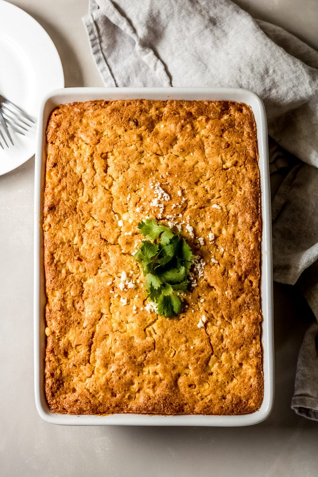 a baked Mexican street corn beef casserole in a white 9x13 baking dish