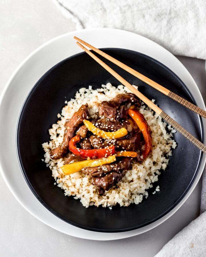 air fryer orange beef in a black bowl