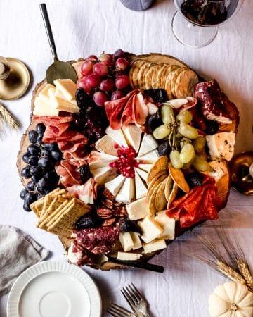 a thanksgiving charcuterie board on a wooden platter