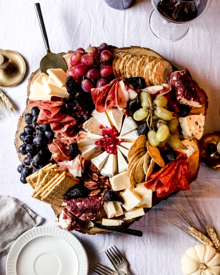 a thanksgiving charcuterie board on a wooden platter