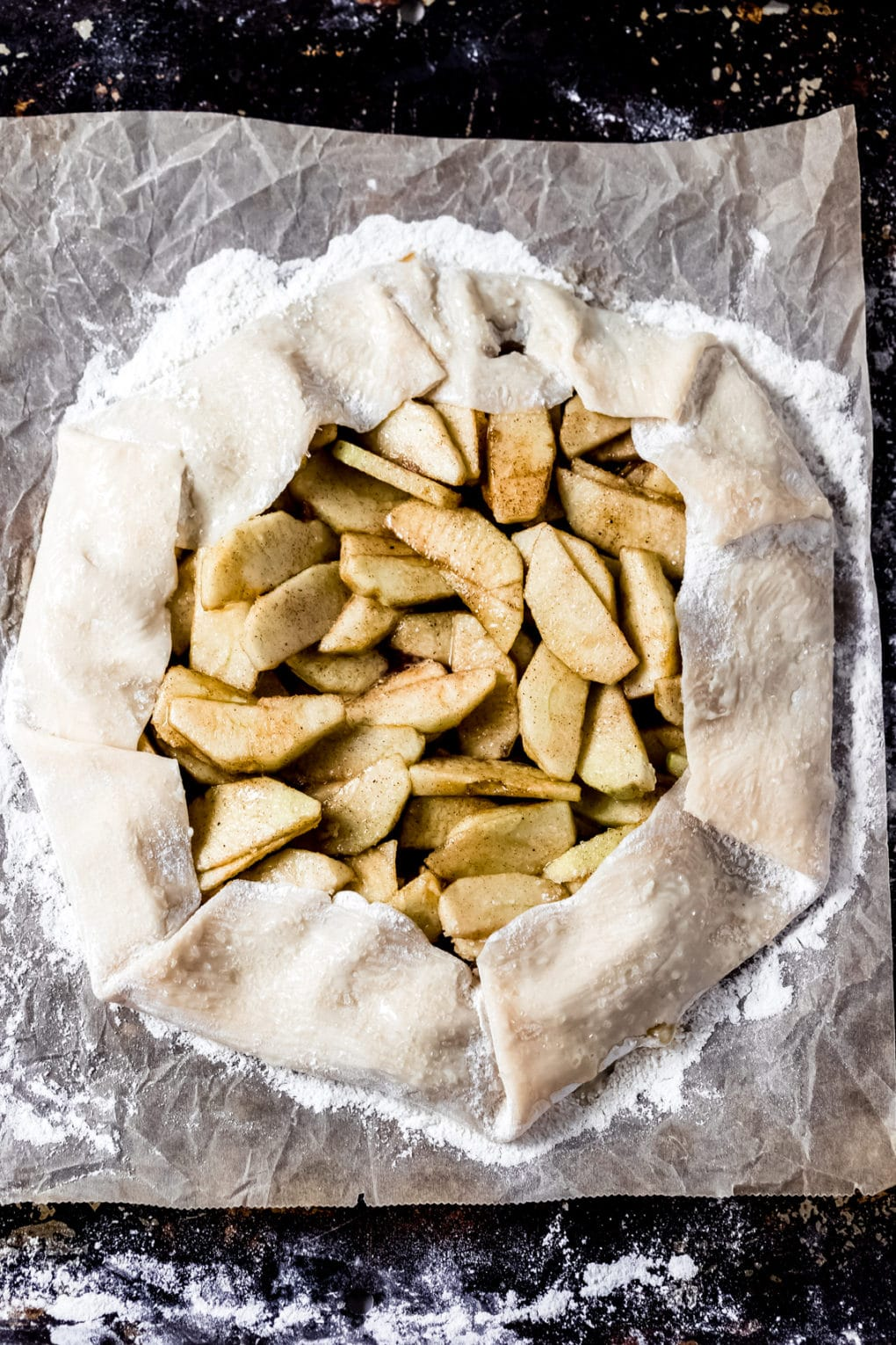 an unbaked caramel apple galette ready to be baked