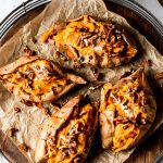 four maple pecan twice-baked sweet potatoes on a round serving platter