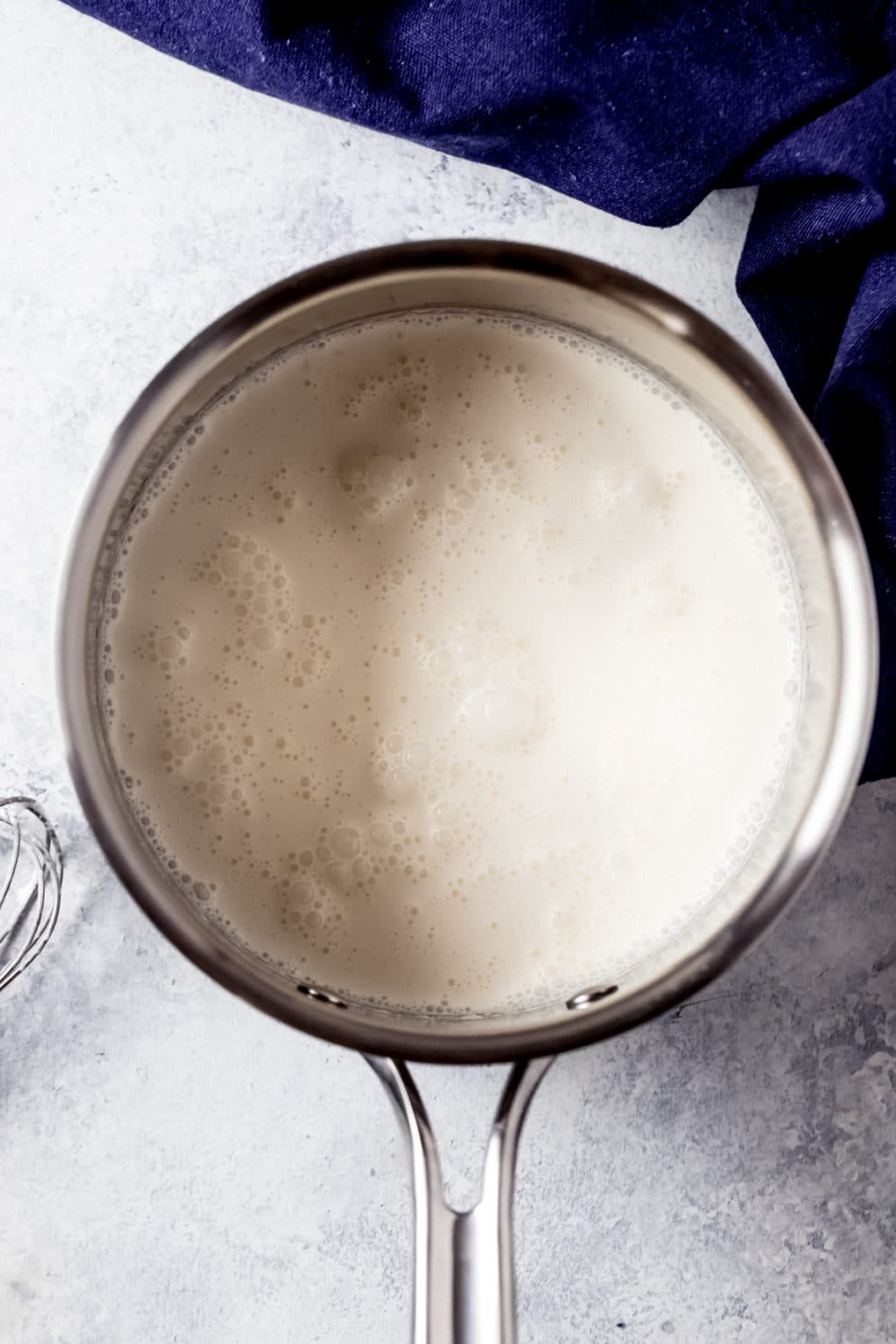 heavy cream cooking in a saucepan