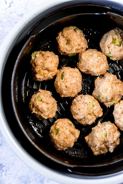 buffalo chicken meatballs in a air fryer basket