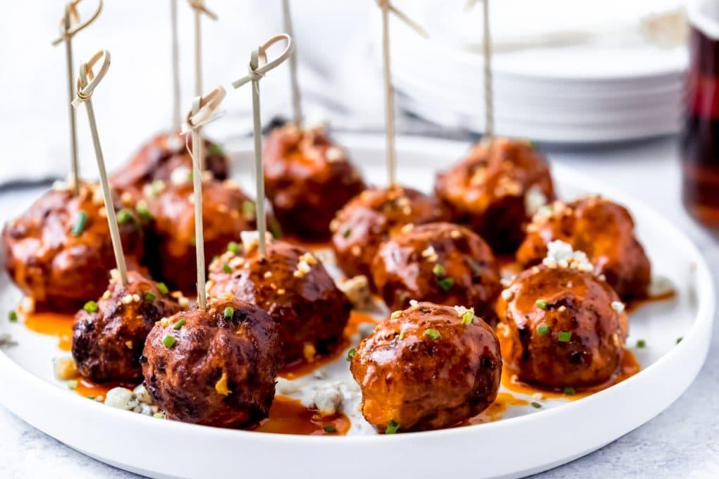 air fryer buffalo chicken meatballs on a white platter
