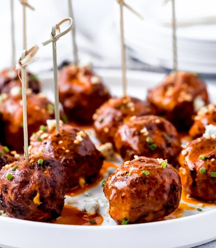 air fryer buffalo chicken meatballs on a white platter