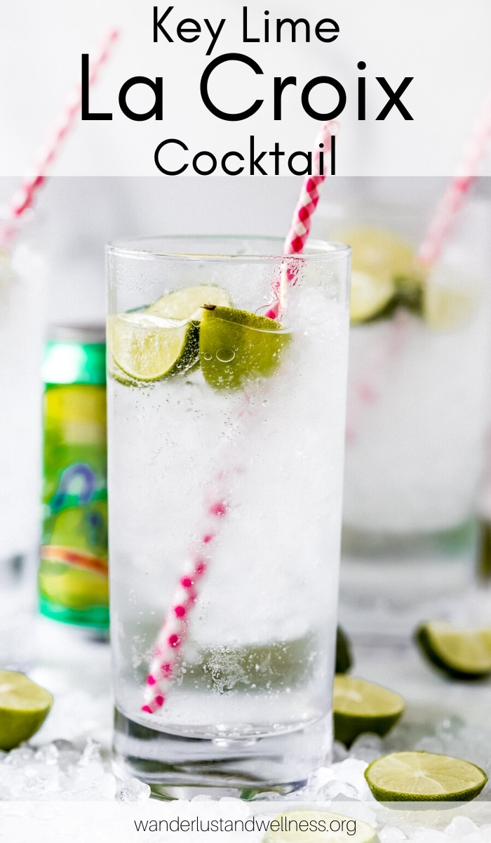 a tall glass of key lime la croix cocktail with a red and white checkered straw in the glass