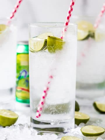 three highball glasses of key lime la croix cocktail