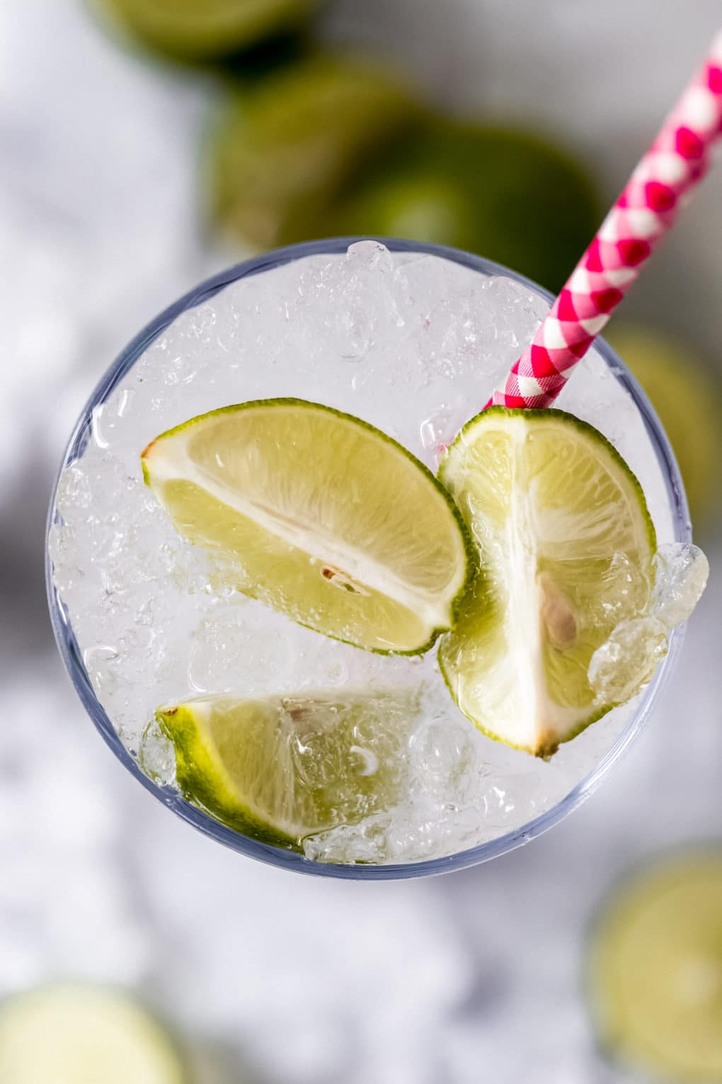 an overhead shot of a key lime cocktail in a highball glass