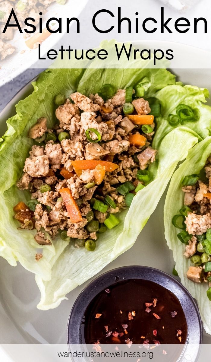 two Asian chicken lettuce wraps on a white plate