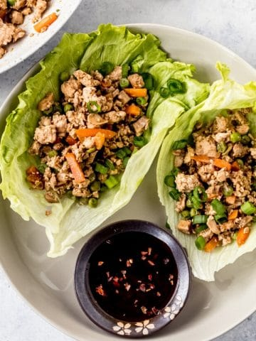 A plate of Asian chicken lettuce wraps