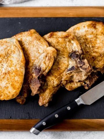 cajun air fryer pork chops on a cutting board