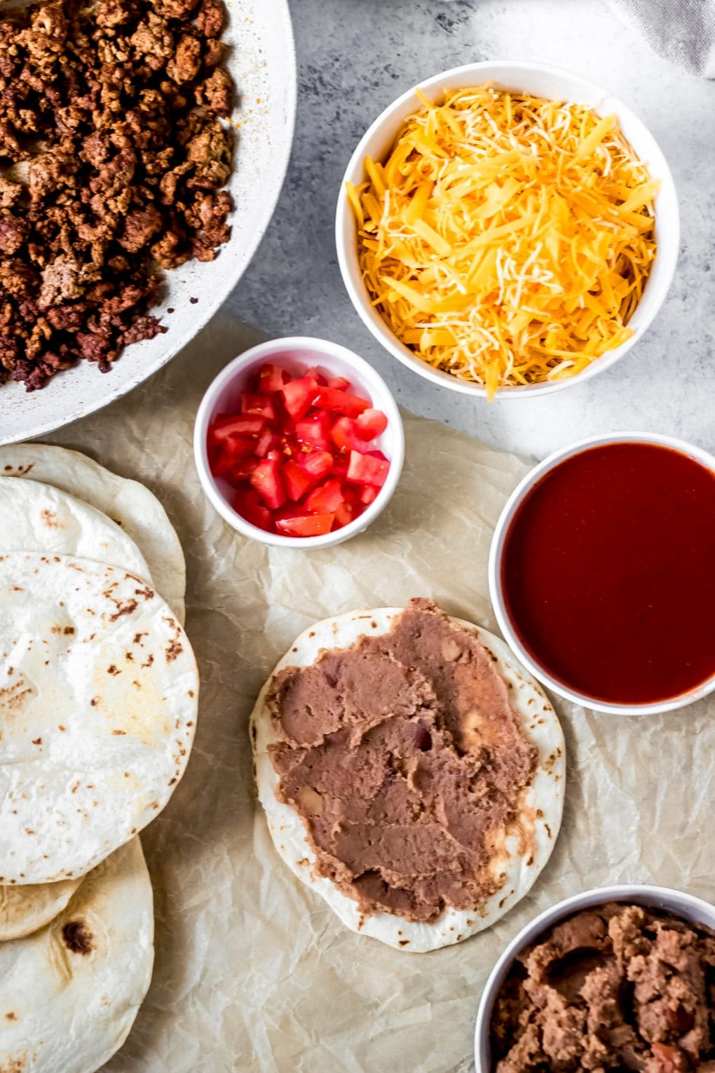 ingredients to make air fryer Mexican pizzas on a table