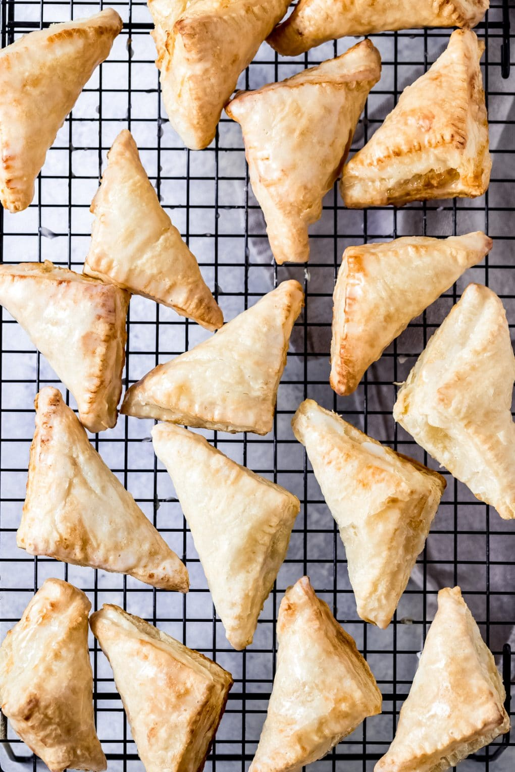 several air fryer apple turnovers on a cooling rack