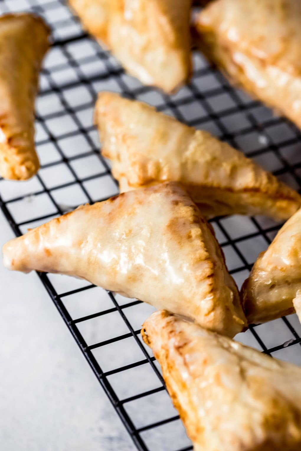 air fryer apple turnovers on a cooling rack