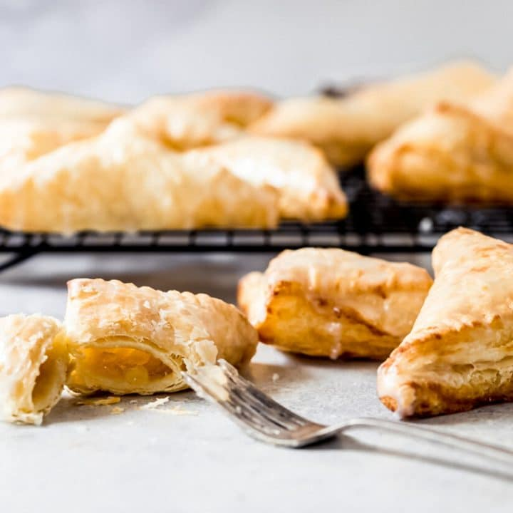 air fryer apple turnovers with one cut open with a fork