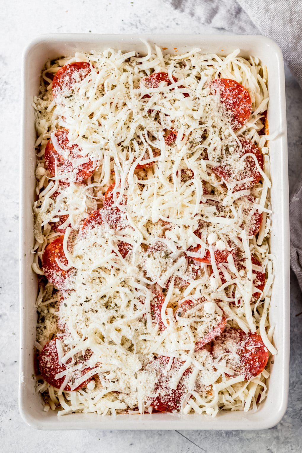 a pizza baked spaghetti casserole ready to be baked