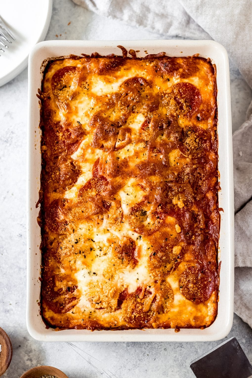 a cooked pizza baked spaghetti casserole