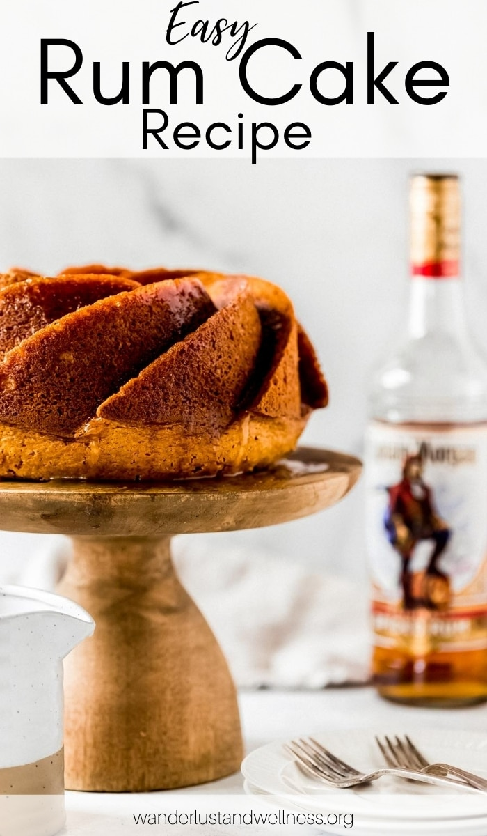 a rum cake on a cake stand