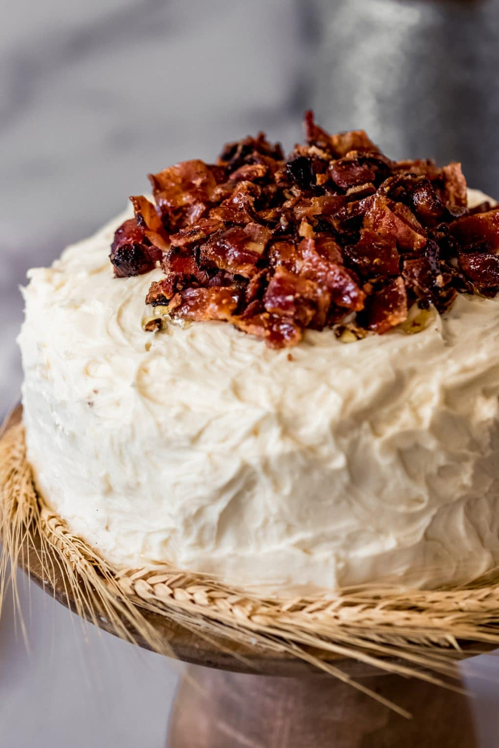 a maple bacon cake on a cake stand