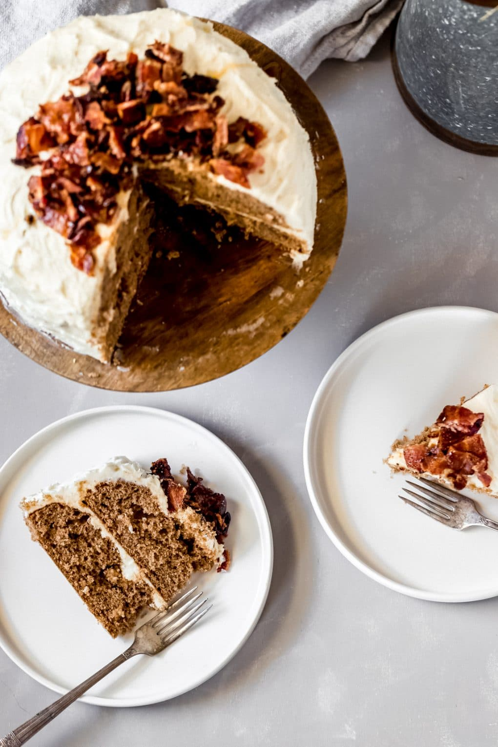 two slices of maple bacon cake on a plate