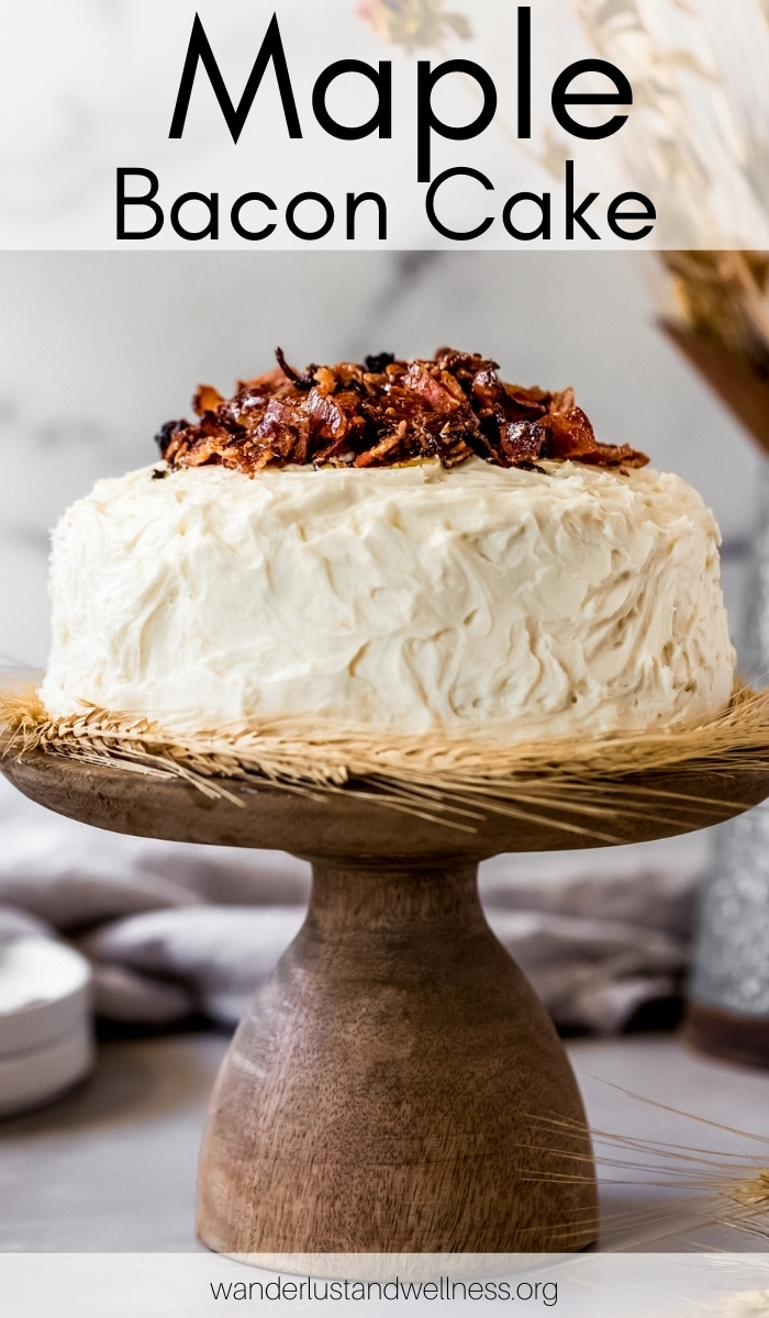 a maple bacon cake on a wooden cake stand